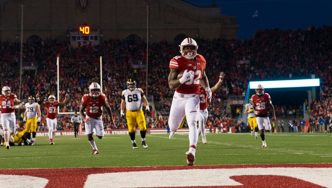 Wisconsin Badgers linebacker Leon Jacobs (32) returns a fumble for a touchdown during the third quarter against the Iowa Hawkeyes at Camp Randall Stadium.