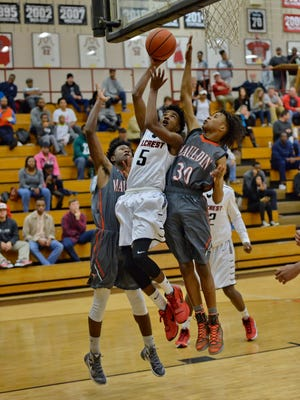 Hillcrest's C.J. Saunders (5) drives to the basket during the Rams' 74-48 victory over Mauldin Friday night.