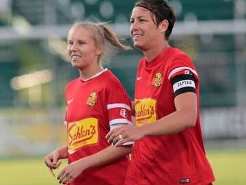 Courtney Wagner, left, was an honorary captain for the Western New York Flash women's soccer team, which included Pittsford's Abby Wambach, during the 2014 season.