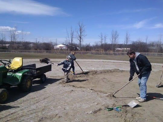 Members of the Blue Water Building Trades donated time to help improve the Port Huron Township Little League fields this spring.
