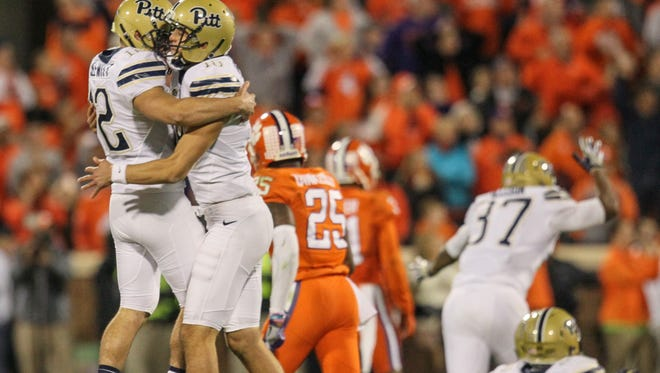 Pitt kicker Chris Blewitt, left, is congratulated by Ryan Winslow after making a 48-yard game-winning field goal against Clemson during the second quarter last Saturday at Memorial Stadium in Clemson.