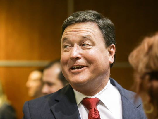 U.S. Rep. Todd Rokita shakes hands with supporters,