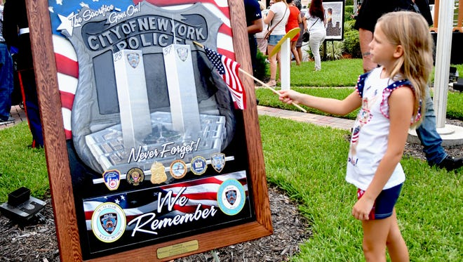 Several hundred people attended Space Coast Remembers, a 9/11 memorial event at The Avenue Viera. A steel I-beam from the wreckage of the World Trade Center is on year-round display there.