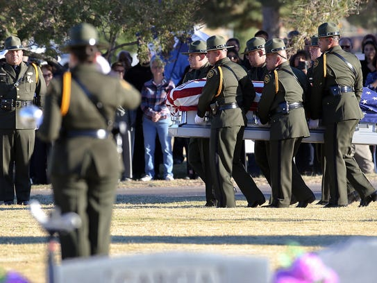 U.S. Border Patrol pall bearers carry the body of fellow