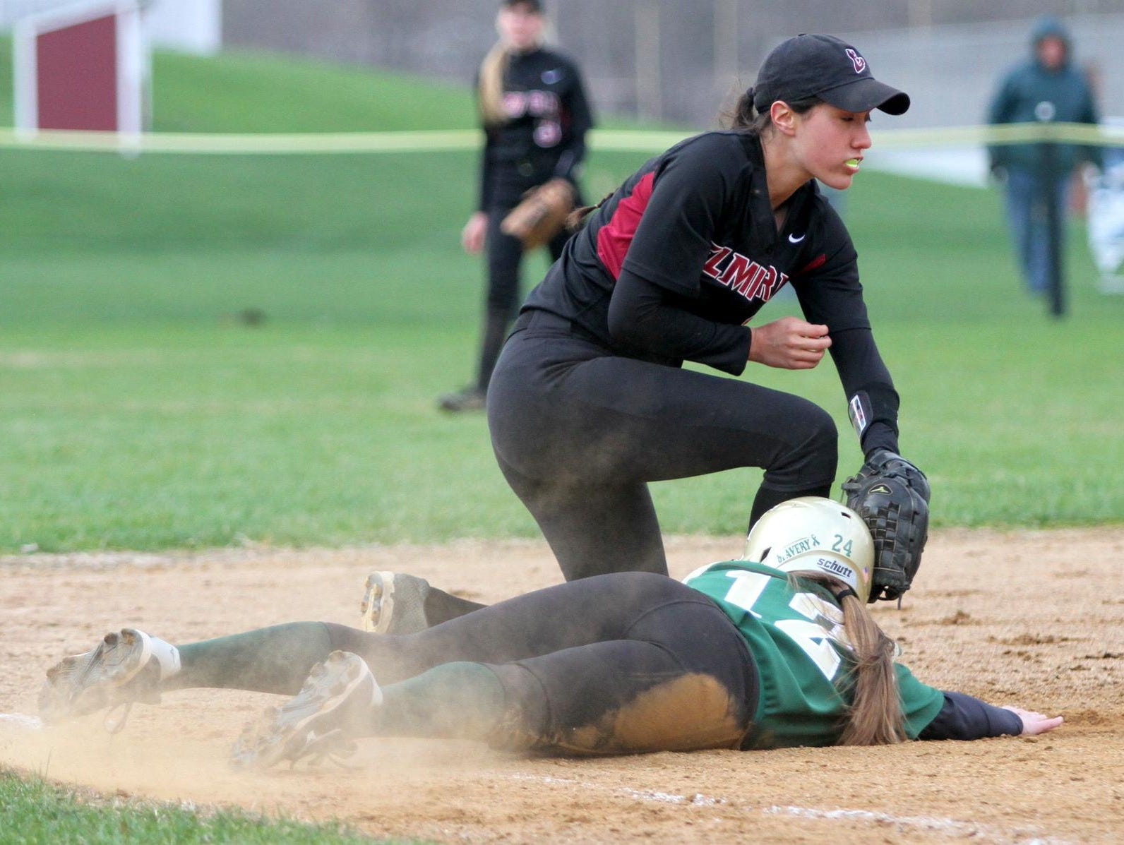 Elmira's Sarah Topping applies a tag against Vestal this past season. She was one of three Express players to earn STAC Metro/West all-conference honors.