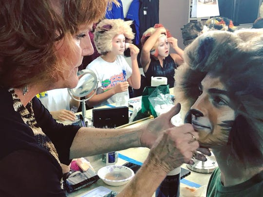 "Ryan McNevin prepares for his role as Rum Tum Tugger with makeup assistance from Broadway veteran Anna McNeeley, who starred in the original Broadway version of ""Cats"" as Jennyanydots"