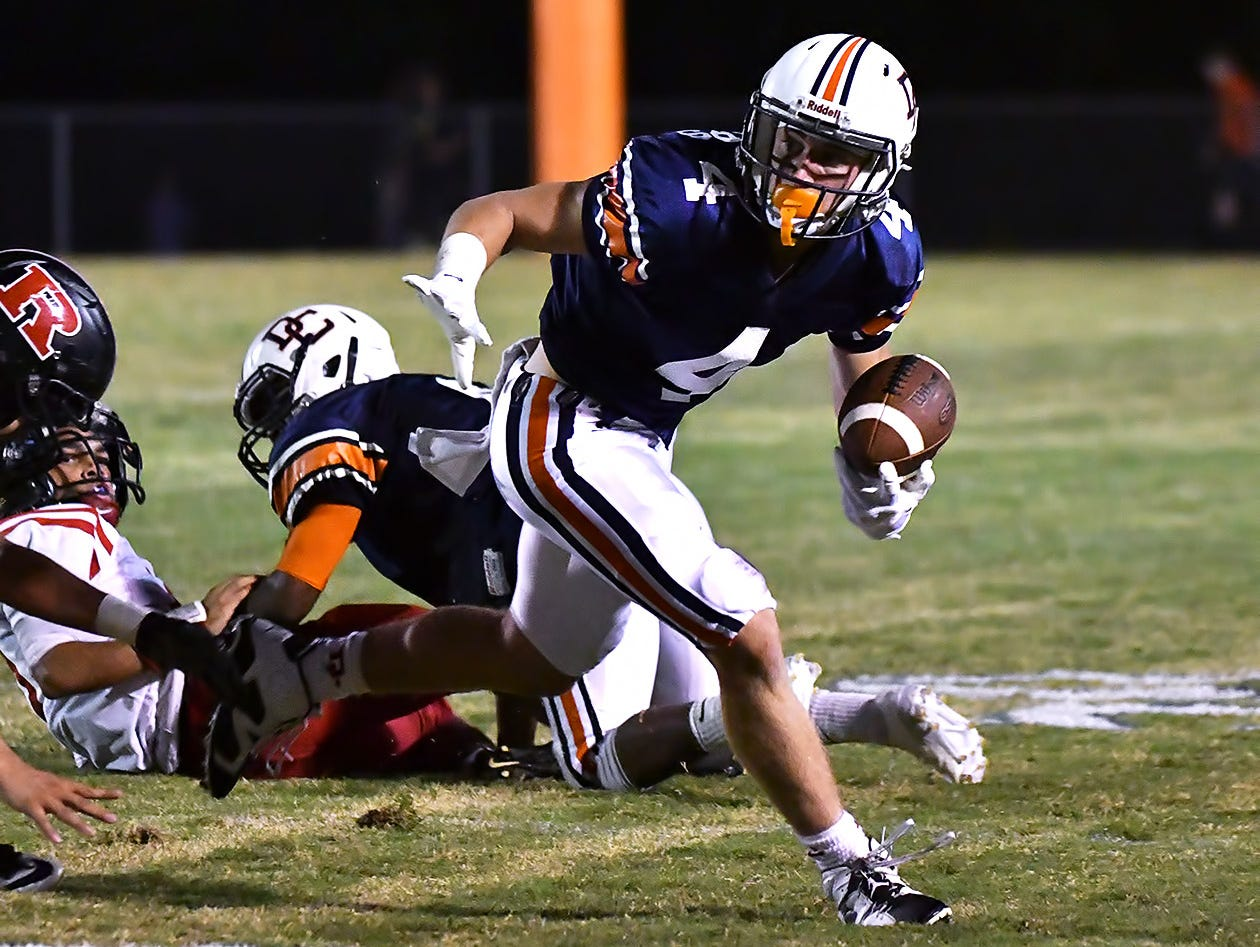 Dickson County's Jack Sensing finds running room after a reception against Rossview. Dickson County vs Rossview. Friday, Sept. 23, 2016 at Dickson County.