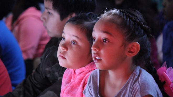 Students listen for their cue Thursday at Ruben S. Torres Elementary as they sing songs for the school's honorary namesake. Mr. Torres was present for the student population's celebration and presentation of Ruben Torres Day at the school.