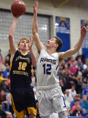 Littlestown's Daniel Gazmen shoots against Kennard-Dale's Joey Thomas in the first half of a PIAA District 3 4A boys' basketball quarterfinal Thursday, Feb. 22, 2018, at Kennard-Dale. Kennard-Dale defeated Littlestown 72-59 to advance in the tournament.