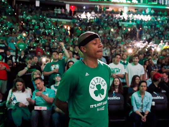Boston Celtics' Isaiah Thomas stands by himself during team introductions before a first-round NBA playoff basketball game against the Chicago Bulls Sunday, April 16, 2017, in Boston. (AP Photo/Michael Dwyer)