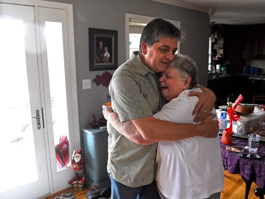 Mike Young hugs his friend Sharon Harrell after he