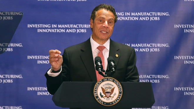Gov. Andrew Cuomo speaks before VP Joe Biden in announcing the expanded development of Photonics technology in the Rochester area.