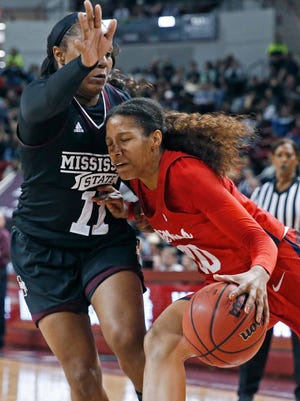 Mississippi guard Madinah Muhammad (20) drives into Mississippi State guard Roshunda Johnson (11) during the second half of an NCAA college basketball game in Starkville, Miss., Thursday, Jan. 11, 2018. Mississippi State won 76-45. (AP Photo/Rogelio V. Solis)