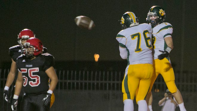 Horizon's Jake Grant (76) and Shane Kortas (7) react to Kortas scoring a touchdown against Paradise Valley at Paradise Valley High School in Phoenix, AZ on Sept. 19, 2013.