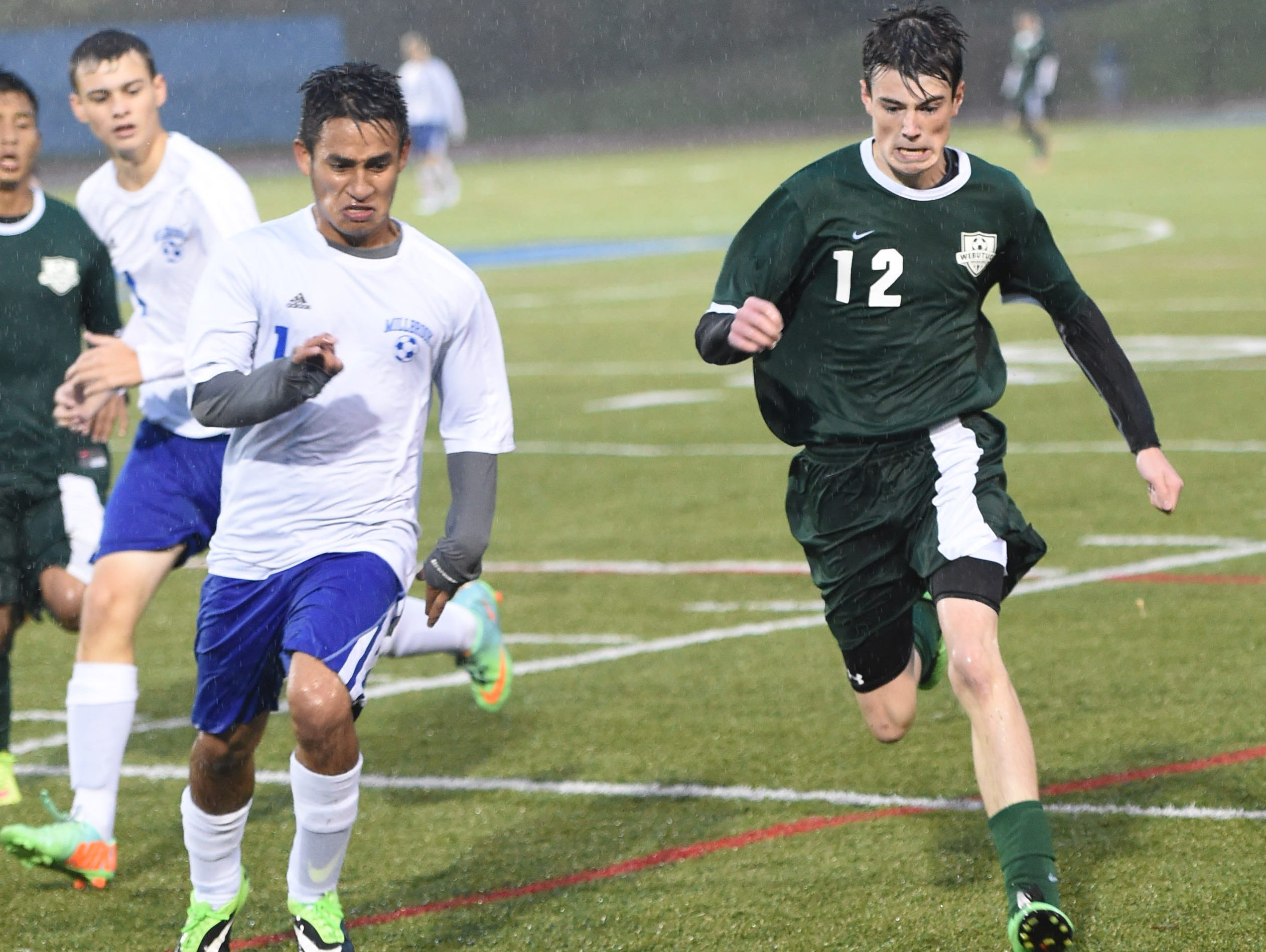 Webutuck's Deven Glover and Millbrook's Bryan Oliveros Martinez charge after the ball during the Section 9 Class C boys soccer championship on Wednesday.
