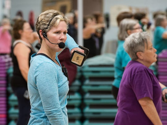 Shelly Seibert, instructor of the Active Older Adults Aerobics Class, leads a class at the Salisbury YMCA on Wednesday, Jan. 24, 2018.