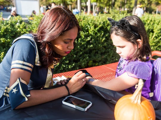 """Costumed children get Halloween decorations during """"No Tricks, Just Treats"""" at Cumberland County College on Monday, October 31."""
