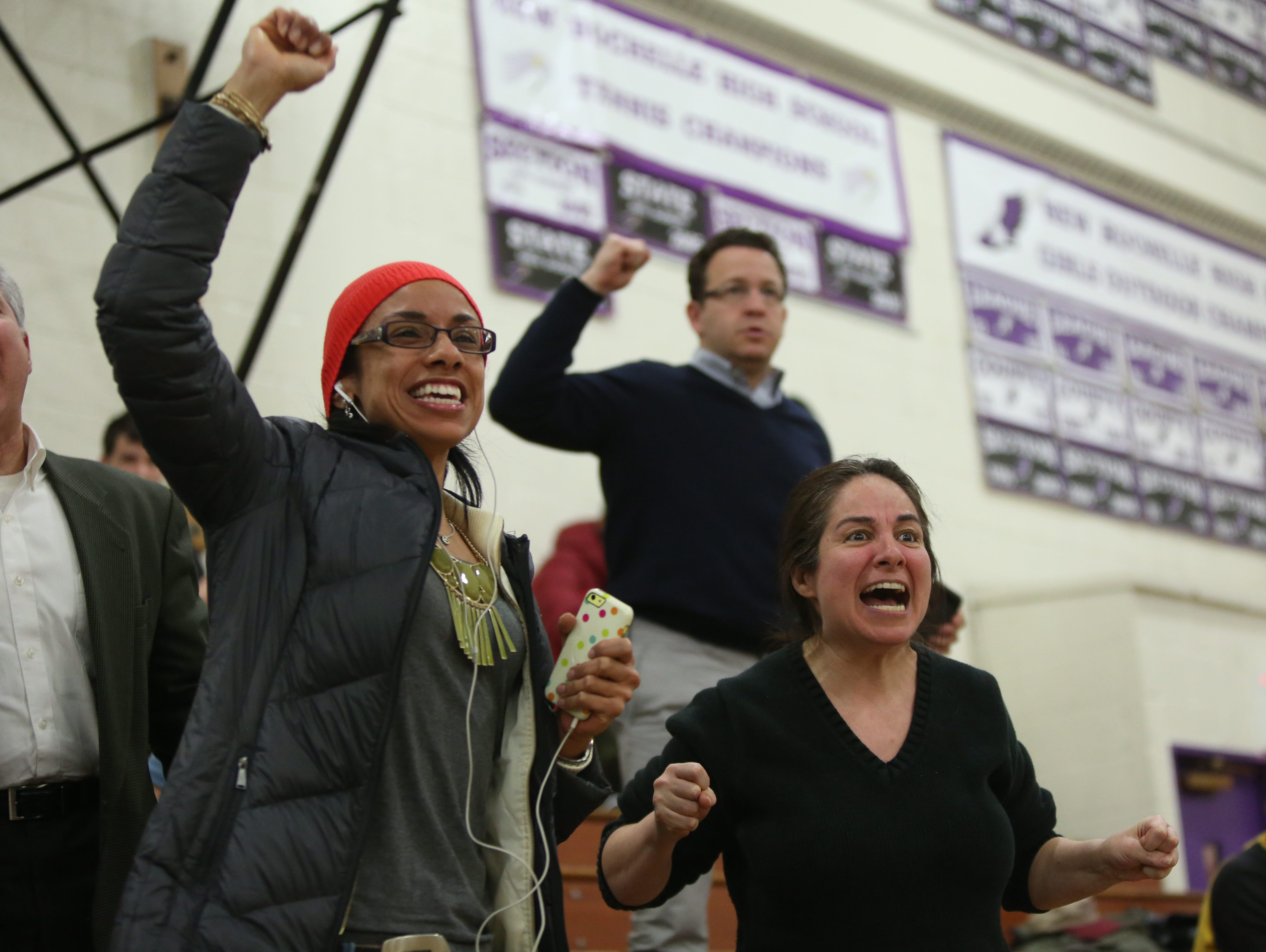 New Rochelle parents Latisha Burgos-Wallace, left, and Hope Tera, right, cheer the boys wrestling team during a match against Yonkers on Jan. 22, 2015.