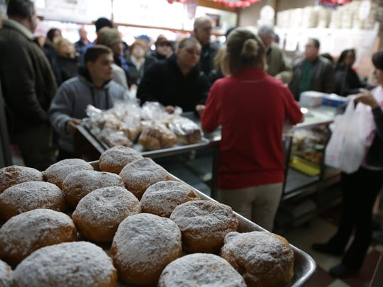A large crowd of customers wait to purchase paczki at New Palace Bakery in Hamtramck on Monday, Feb. 11, 2013.