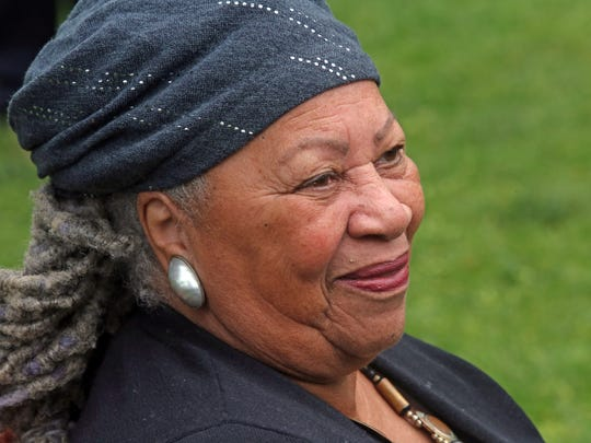 Toni Morrison, left, speaks during a ceremony for the unveiling of Nyack's Bench by the Road in Nyack May 18, 2015. The bench commemorates the life of abolitionist Cynthia Hesdra, a former slave who became an entrepreneur. The Toni Morrison Society created the bench project to create spaces to summon the history of slavery of Africans in the United States and the Caribbean, and to reflect on the absence of their stories in our historic teachings.