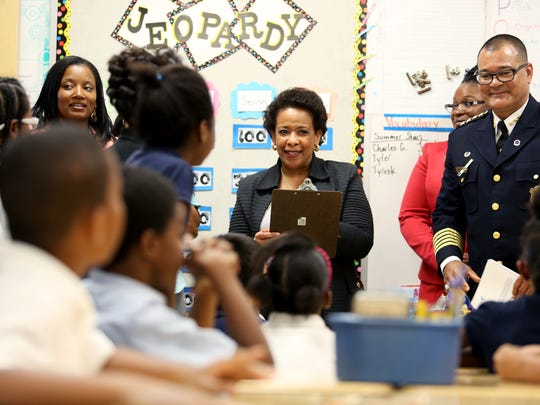 U.S. Attorney General Loretta Lynch (center) and Cincinnati Police Chief Jeffrey Blackwell visit a third-grade class at Chase Elementary School in Northside.