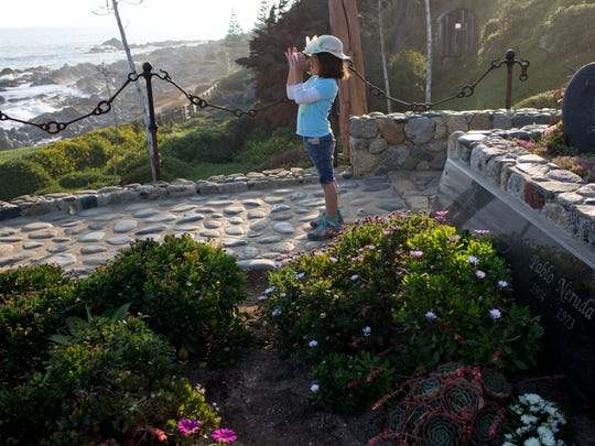 A young visitor looks out at the Pacific Ocean at Neruda's home in Isla Negra.