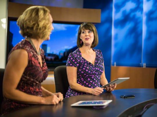 WHO-TV anchor Erin Kiernan talks with Sonya Heitshusen July 24 before the 5 p.m. news broadcast.