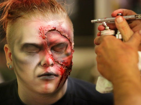 Sam Stinemates has finishing makeup applied behind the scenes at the Burial Chamber in Neenah.