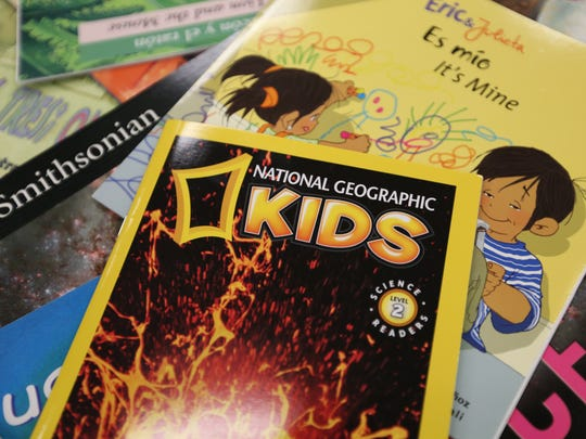 A stack of children's books used during the SMART (Start Making A Reader Today) program Thursday, Nov. 5, 2015, at Englewood Elementary School in Salem.