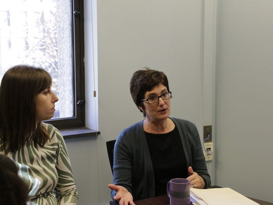 Margo Monteith, professor of psychological sciences at Purdue University, talks to her research team, Tuesday, Dec. 1, 2015, about the Diversity Transformation Award. Monteith's proposal was one of 66 selected for funding.