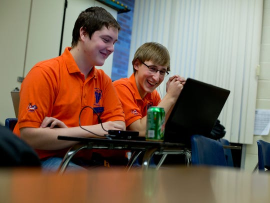 Capac team members Austin Newman, 17, and Chad Soucek,