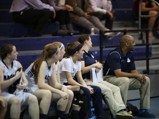 Maclay senior Ellie Stubblefield (headband) watches her team play in a District 1-3A semifinal on Tuesday at John Paul II. Stubblefield sat out with a concussion but leads the Marauders with 14.7 points per game.