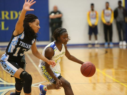 Rickards senior Katelyn Marshall tries to drive past Ribault's Nola Carter during Friday's Region 1-5A final, won by Ribault 68-32.