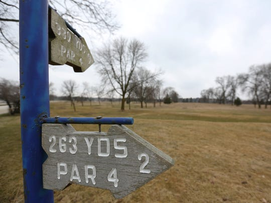 The nine-hole golf course signs of the former Elks Club in April 2016.