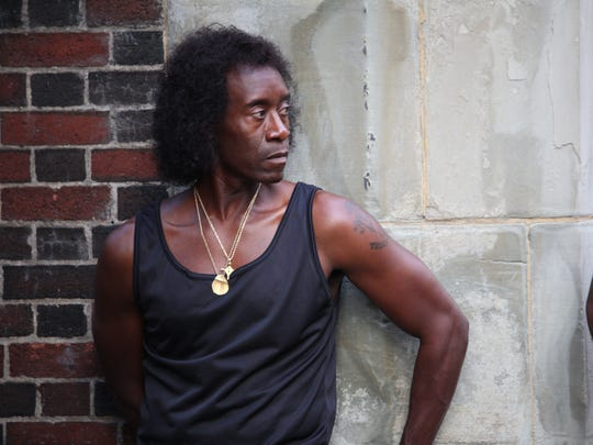 Don Cheadle as Miles Davis.