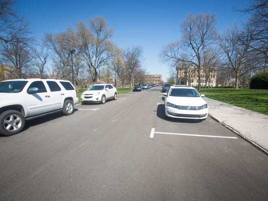 Cars park along the sides of Campus Drive through the