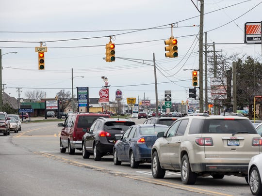 Vehicles travel through the intersection of 24th and