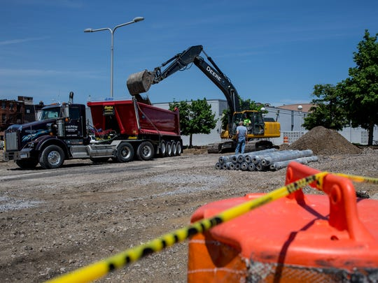 Contractors work on the East Quay parking lot Tuesday,