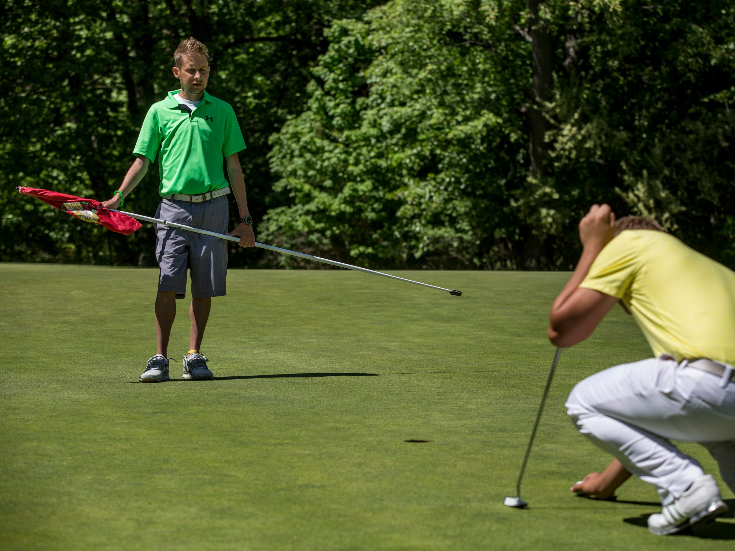 Kyle Bailey watches as his brother Nick Bailey lines up his putt Friday, June 3, 2016 at the Port Huron Golf Club.