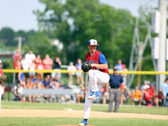 Roncalli's Michael McAvene delivers a pitch during the Rebels' 8-5 semistate victory Saturday against Center Grove.
