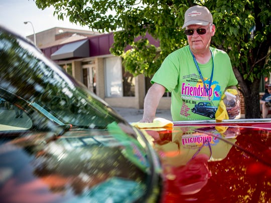 Jeffrey Drake of Grand Blanc polishes his 1957 Chevrolet BelAir during the Back to the Bricks Friendship Promotional Tour Saturday, June 11, 2016 in downtown Port Huron.