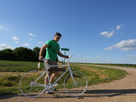 Nate Cline, 39 of Des Moines, carries a ghost bike