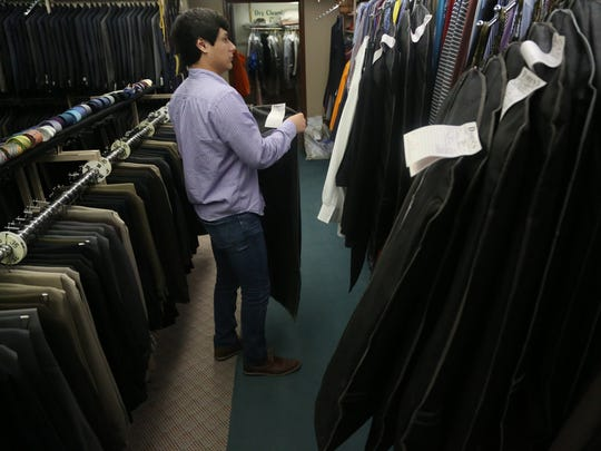 Jose Freed, 20 of Cherokee, checks in a tux at Darren's
