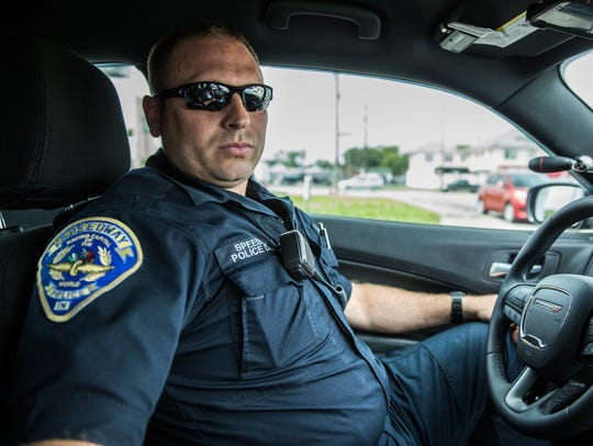 Alex Redding, a 36-year-old police officer in Speedway,