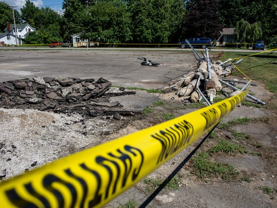 An existing court is being dismantled and is roped off Tuesday, July 26, 2016 at Lion's Field park in Algonac. A $100,000 grant from the Michigan Department of Natural Resources Land and Water Conservation Fund is is helping to fund a new parking lot and drop-off area near the pool, new pickleball and basketball courts, two pavilions, horseshoe pits, benches and walkways.
