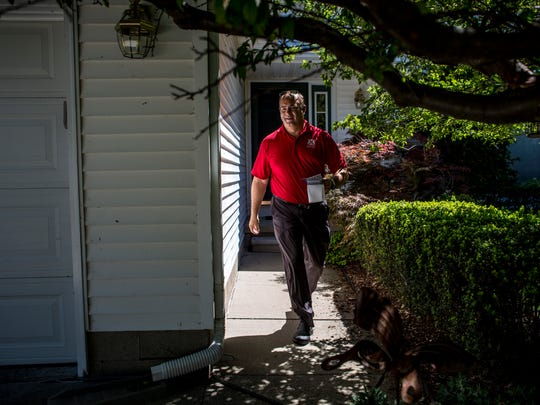 Anthony Forlini, of Harrison Township, walks door-to-door to promote his campaign Tuesday, July 26, 2016 on Jack Pine Lane in Port Huron. Forlini, a republican, is running for Congress in Michigan's 10th Congressional District