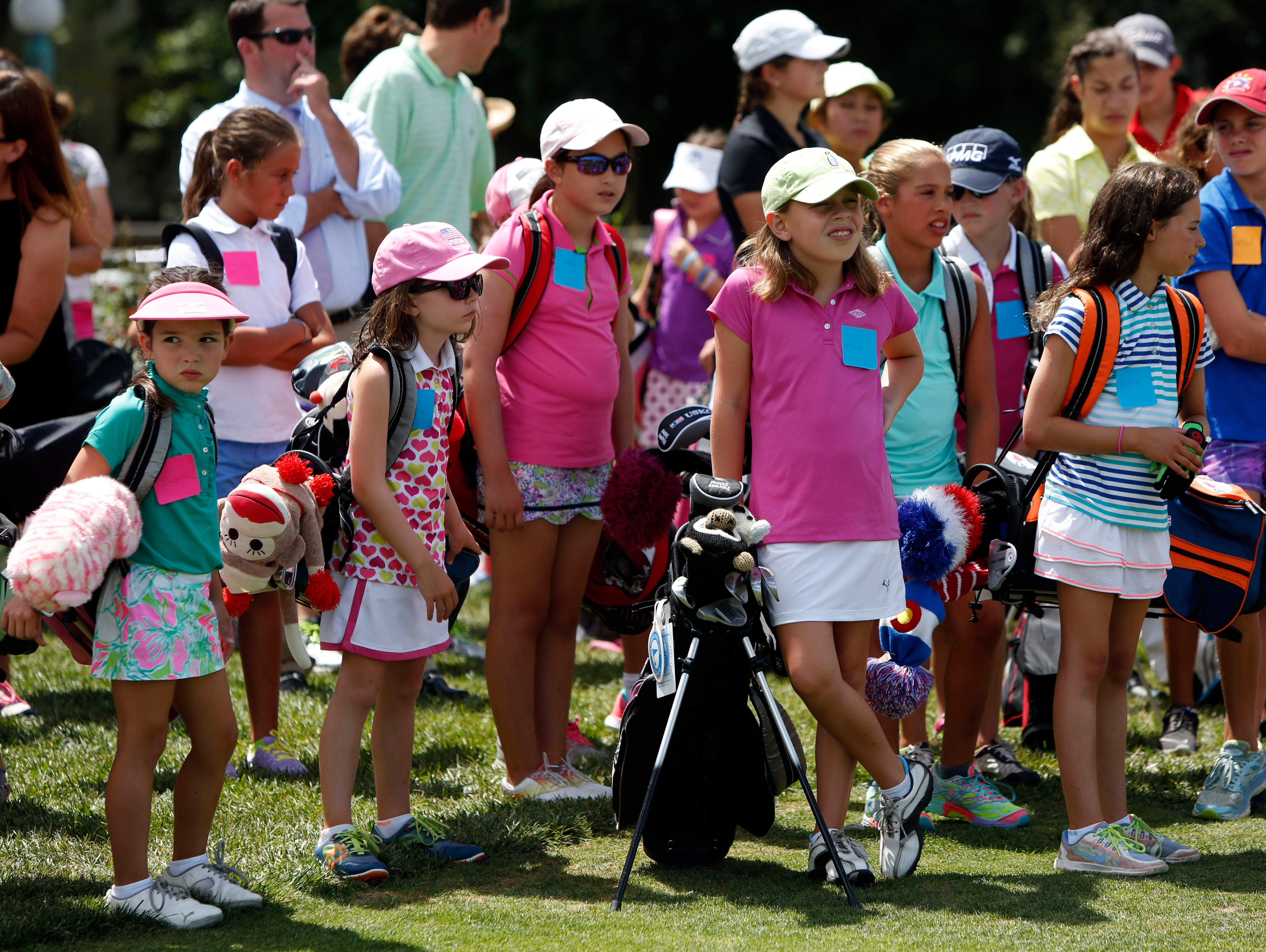 Girls attend the Women's Metropolitan Golf Association's annual Girls to the Tee event at Westchester Country Club in Rye, Aug. 8, 2016. The free clinic, for girls ages 6-18, is an afternoon of instruction and networking to help show girls who are learning the game that they are part of a larger group.