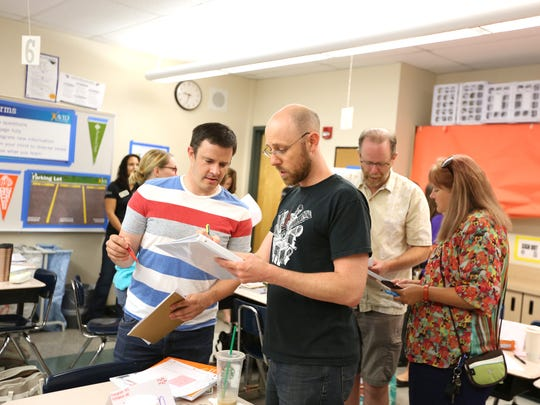 """David Bleak, left, of Cedar Park Middle School and Zach Winterspring of Park Rose High School participate in a """"student success"""" session during AVID training on Thursday, Aug. 11, 2016, at Claggett Creek Middle School in Keizer. About 300 educators from across the state attended the two-day event. AVID is a global nonprofit focused on supporting schools to get students college ready and close the achievement gap."""