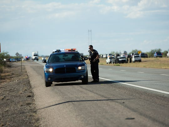 A Las Cruces Police Department officer guards the perimeter