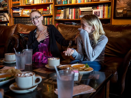 Michelle Redden, 33, laughs and cries along with her daughter, Raelynn, 11, as they talk about how their family has dealt with Michelle's cancer diagnosis while having lunch Wednesday, September 14, 2016 at The Raven Cafe in Port Huron. Michelle was previously in partial remission from cervical cancer, but received a terminal diagnosis in August.
